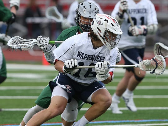 Wappingers defender Zach Timmons handles the ball during a March 2018 game against Brewster.