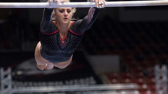 Southern Utah University sophomore Autumn Jorgensen performs her routine on the double bars at the Mountain Rim Gymnastics Conference in the America First Event Center Saturday, March 24, 2018.