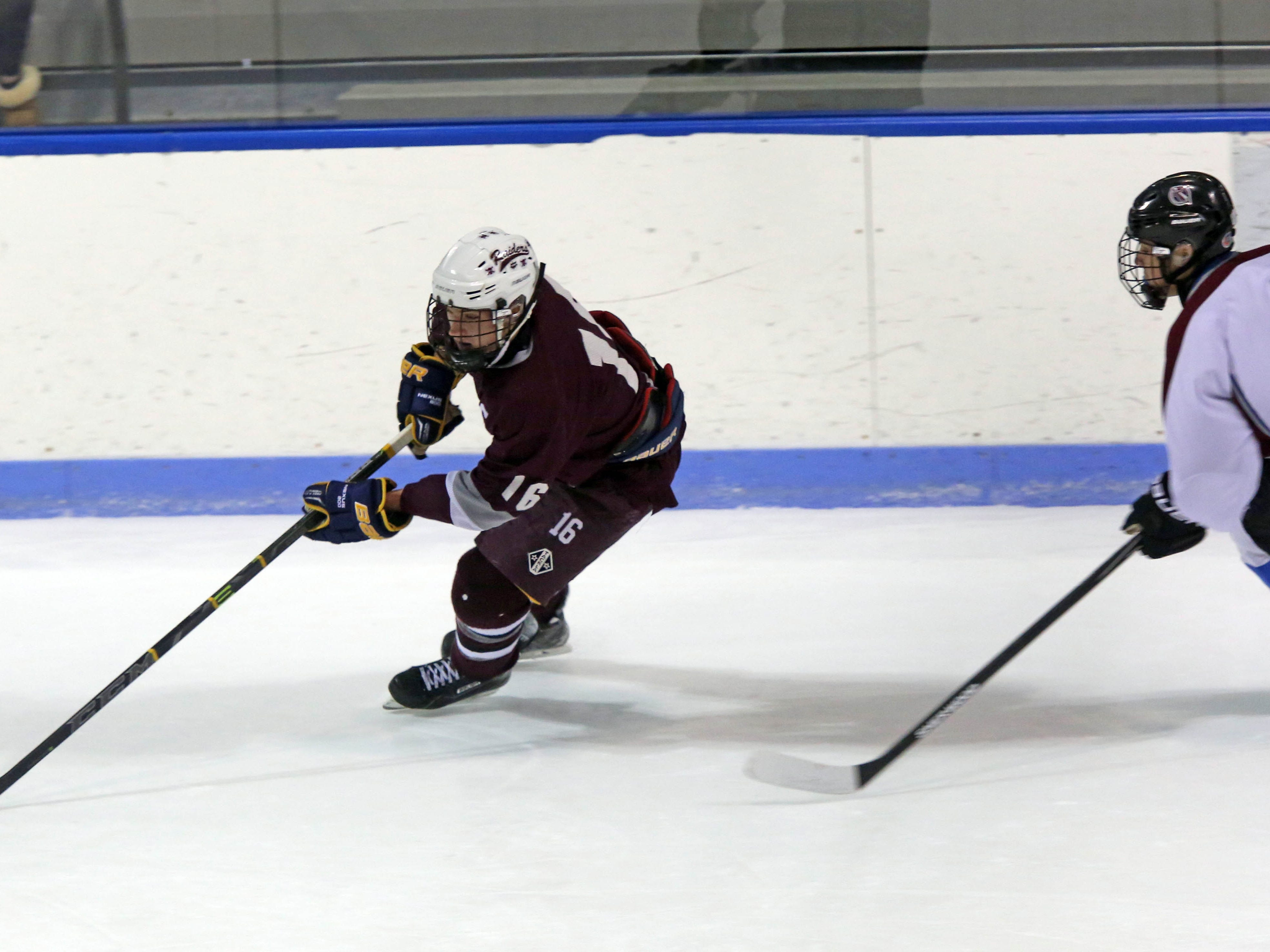 Scarsdale's James Nicholas (16) gains control of the puck over Rye Town/Harrison's Ike Murov (4) during boys hockey at Rye Playland on Jan. 12, 2015.