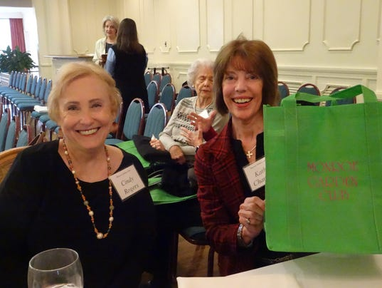 Cindy Rogers and Cathy Chandler selling reusable totes to support beautification projects.