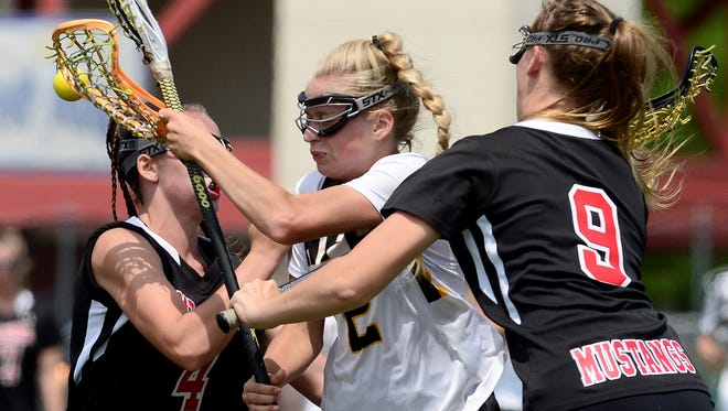 HF-Ls Payton Reed, center, tries to split the defense of Mount Sinai's Hailey Dillon, right, and Emma Tyrrell during the 2017 NYSPHSAA Girls Lacrosse Championships Class C final at SUNY Cortland on Saturday, June 10, 2017.