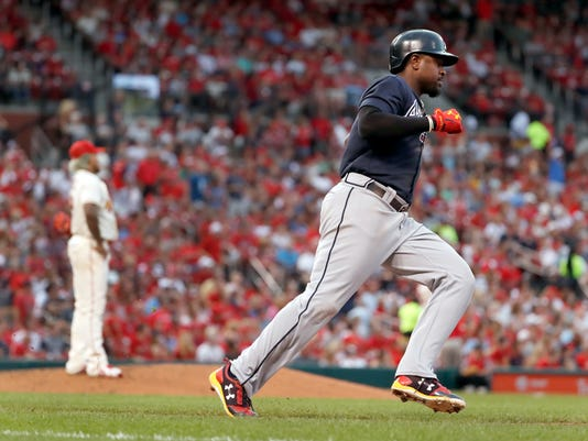 Atlanta Braves' Brandon Phillips, right, rounds the bases after hitting a solo home run off St. Louis Cardinals starting pitcher Carlos Martinez during the fifth inning of a baseball game Saturday, Aug. 12, 2017, in St. Louis. (AP Photo/Jeff Roberson)