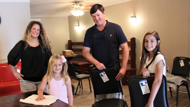 Todd and Ashley Young, along with daughters Morgan, 10, and Madison, 6, plan to reopen Young's Cafe in Pendleton 27 years after Todd's parents' restaurant closed.