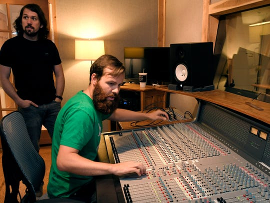 Students Brian Sørenson and Silas Boyle work in a recording