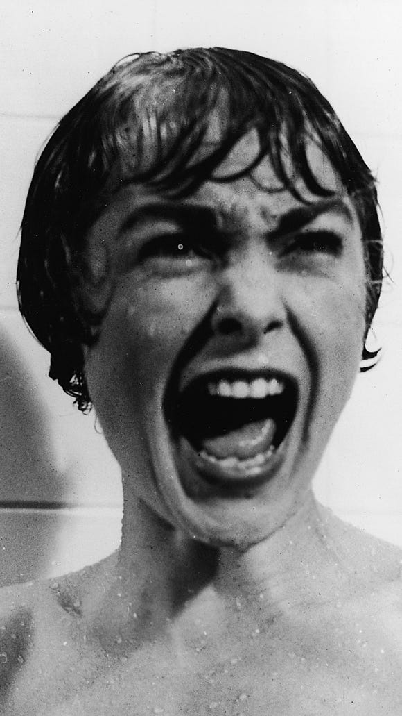 Janet Leigh screams in the shower in the famous scene from the film 'Psycho' directed by Alfred Hitchcock.