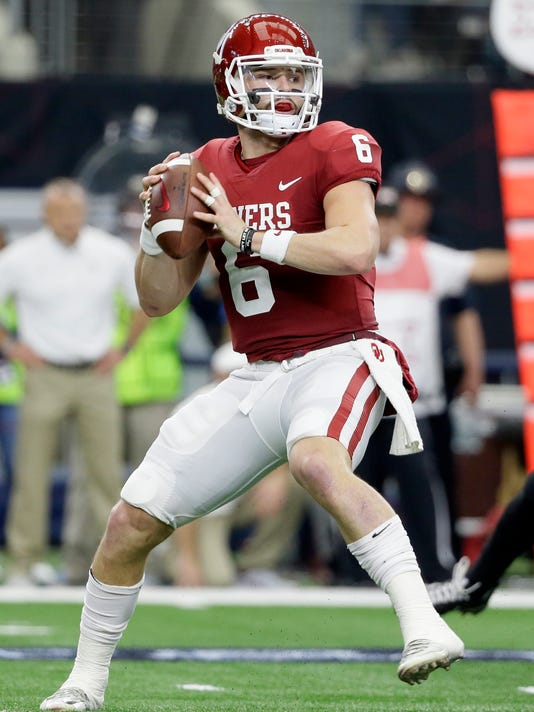 File-This Dec. 2, 2017, file photo shows Oklahoma quarterback Baker Mayfield (6) dropping back to pass in the first half of the Big 12 Conference championship NCAA college football game against TCU in Arlington, Texas.  Mayfield, offensive tackle Orlando Brown and tight end Mark Andrews of Oklahoma were selected to the Associated Press All-America team, giving the Sooners more players on the first team than any school. The All-America team, selected by a panel of 17 Top 25 voters, was released Monday, Dec. 11, 2017.  (AP Photo/Tony Gutierrez, File)