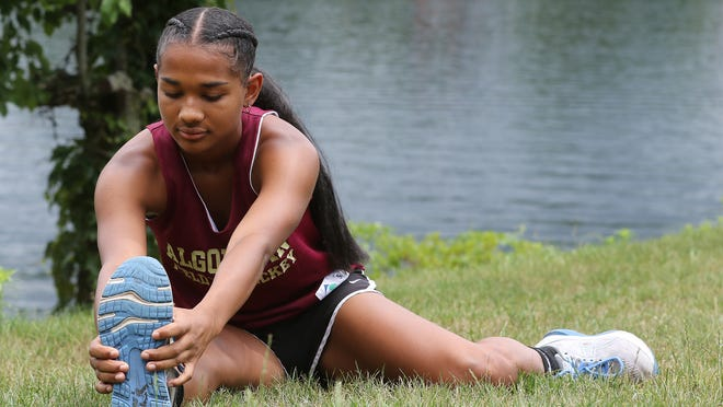 Day Ruffo, 16, shown at her home in Worcester on July 1, 2020, stretches out before going jogging in her neighborhood. She is going to be a senior this year at Algonquin Regional High School, competing in field hockey as well as track and field.