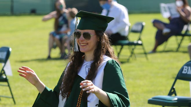 """As """"Pomp and Circumstance"""" was playing for her graduation group, Billerica Memorial High School senior Deidra Anderson, 18, felt the need to conduct it as she waited for the start of the ceremony Monday, June 8, 2020."""