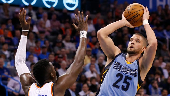 Memphis Grizzlies forward Chandler Parsons (25) shoots over Oklahoma City Thunder guard Victor Oladipo (5) during the second quarter of an NBA basketball game Wednesday in Oklahoma City.