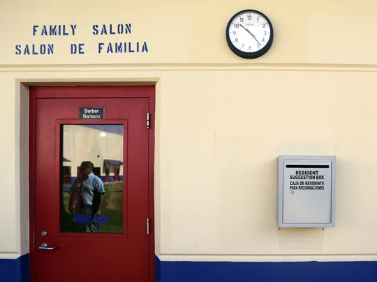 A suggestion box hangs on the wall outside of the hair salon at the Karnes County Residential Center, Thursday, July 31, 2014, in Karnes City, Texas. Federal officials gave a tour of the immigration detention facility that has been retooled to house adults with children who have been apprehended at the border. (AP Photo/Eric Gay) ORG XMIT: TXEG120