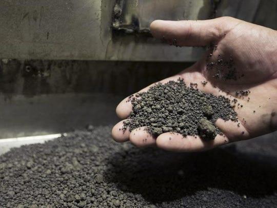 Heat-dried sewage sludge pellets to be screened in a factory on Jones Island to provide a uniform size for Milorganite fertilizer.