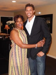 Louisville star Damion Lee with his mother, Michelle Riddick.