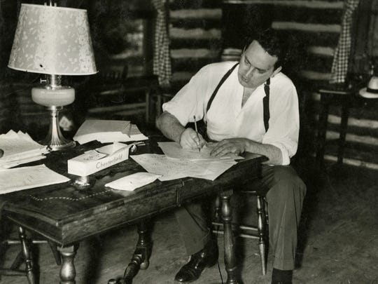 Thomas Wolfe writes at his desk in the Oteen cabin