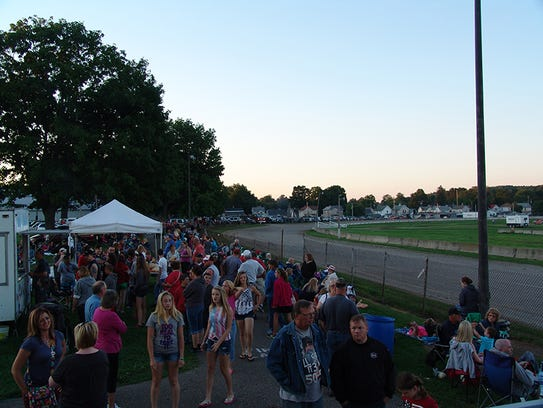 People gather for the 2014 Fourth of July Celebration at the Coshocton County Fairgrounds presented by the Coshocton Towne Centre Association.