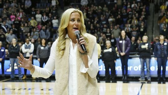 Former Purdue great Katie Douglas speaks at halftime of the Boilermakers game with Indiana Sunday, Jan. 10, 2016, at Mackey Arena. Purdue beat Indiana 63-53.