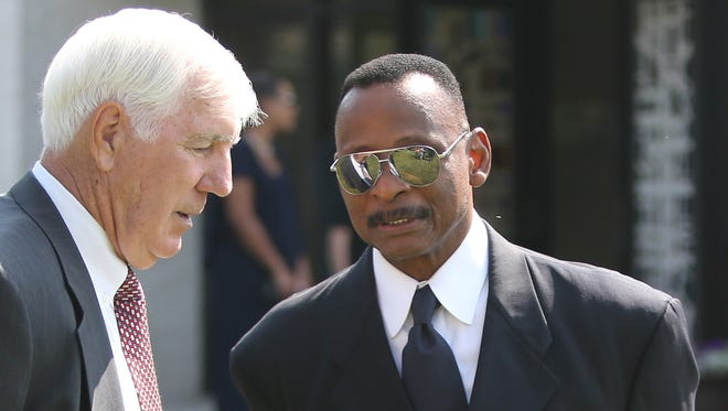 Ex-Lion Mel Farr, right, talking to Greg Landry before services for the late Detroit Lions Hall of Fame receiver Charles Sanders on July 11, 2015.