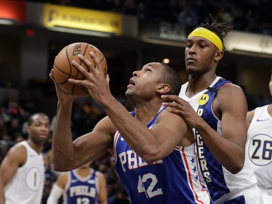 Philadelphia 76ers' Al Horford (42) goes up against Indiana Pacers' Myles Turner (33) during the second half of an NBA basketball game, Monday, Jan. 13, 2020, in Indianapolis. Indiana won 101-95. (AP Photo/Darron Cummings)