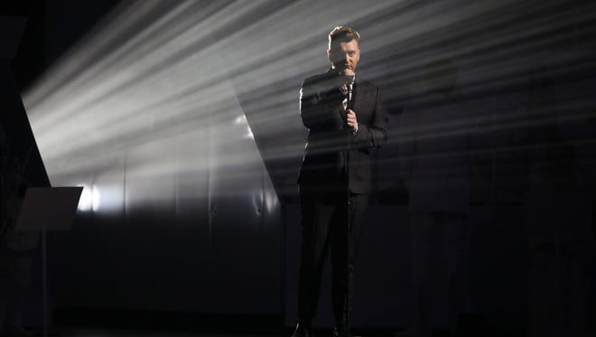 Sam Smith performs onstage at the Brit Awards 2015 at the 02 Arena in London, Wednesday, Feb. 25, 2015.