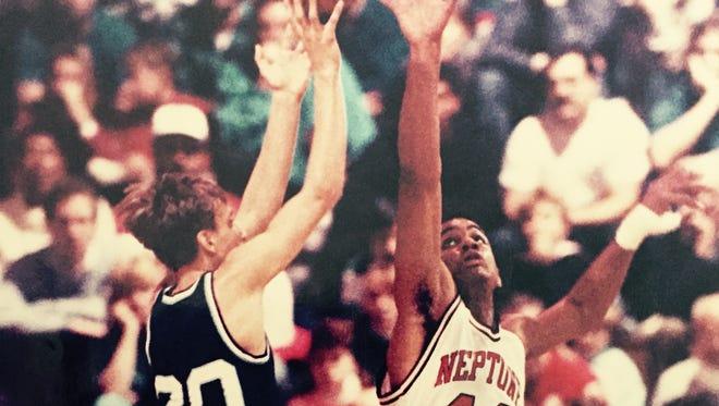 CBA's Keith Kurowski shoots over Neptune's Dan Golembiewski during the 1990 Shore Conference Tournament final, won by CBA, 42-30.