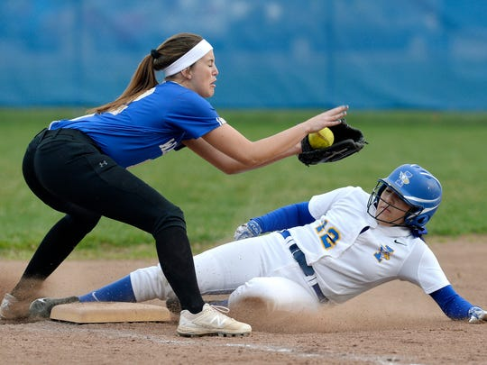 Irondequoit's Marlayna Cartagena, right, slides safely into third base under Webster Schroeder's Emily Willis-Nersinger during a regular season game at Irondequoit High School, Friday, April 27, 2018. Webster Schroeder beat Irondequoit 5-3.