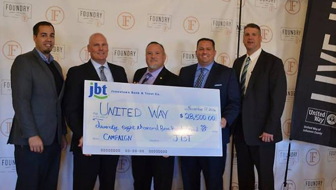 From left: Kenny Montijo, CEO of United Way of Lebanon County, accepts a $28,500 campaign donation delivered by JBT President and CEO, Troy Peters, with JBT representatives Ed Martel, Paul Stauffer and Rodney Becker.