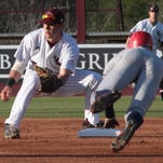 ULM's Kodie Tidwell makes the tag on South Alabama's Adam Ballew during action at Warhawk Field on Friday.