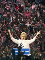 Hillary Clinton gestures to supporters during a primary