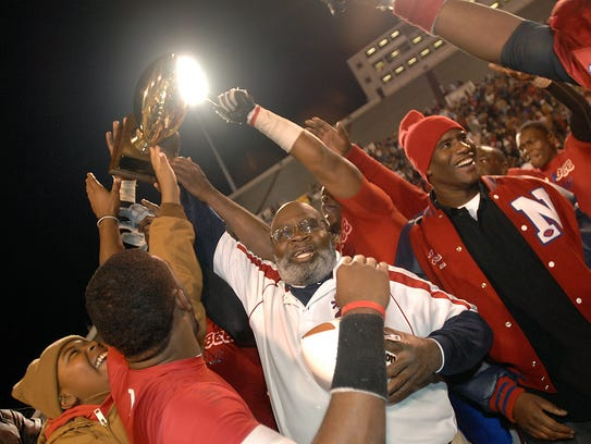 Noxubee County High Coach M.C. Miller (center) celebrates