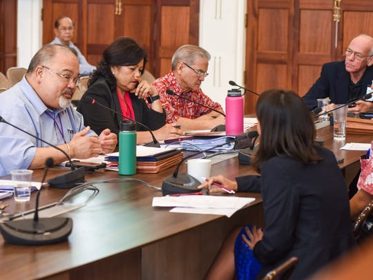PeterJohn Camacho, left, Guam Memorial Hospital Authority administrator answers an inquiry from Sen. Régine Biscoe Lee during a work session between hospital management and the lawmakers at the Guam Legislature on Thursday, Feb. 8, 2018.
