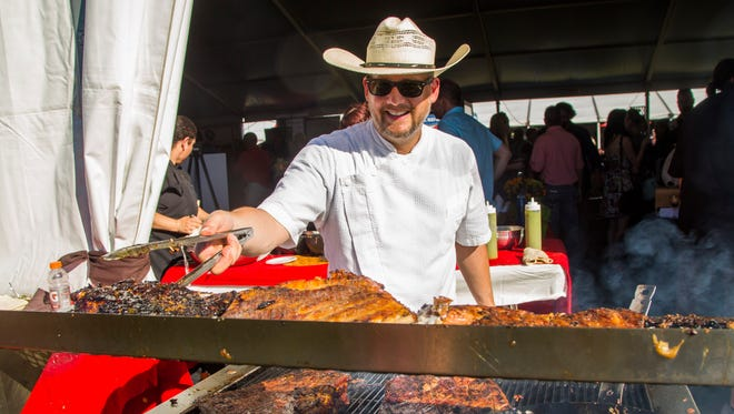 Chef Doug Robson of Otro Cafe cooks up some pork belly as fresh flour tortillas are grilled at azcentral.com Food and Wine Experience on Nov. 5, 2016, at Salt River Fields at Talking Stick.