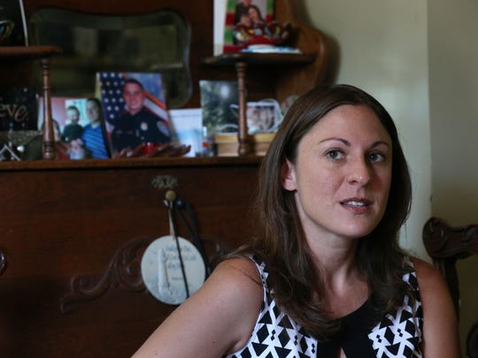 Amy Pierson speaks with David Andreatta at her parents' home in East Rochester.