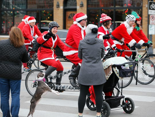 Santas take to the streets by bike for the annual Santa