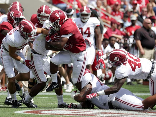 Alabama running back Josh Jacobs carries the ball during