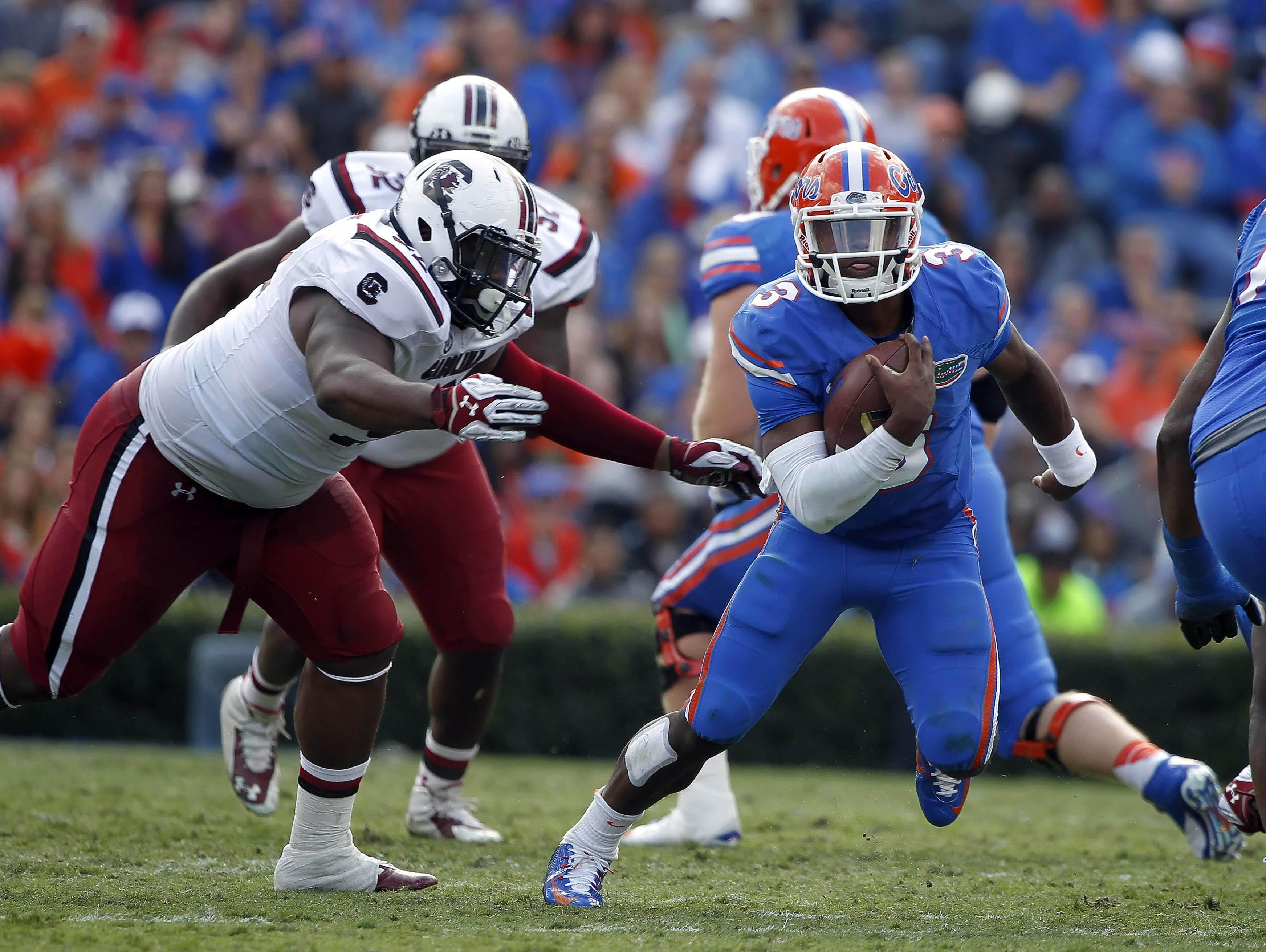 USC defensive tackle Gerald Dixon Jr., right, shown in a 2014 game against Florida, says the team will feature a defensive line with better conditioning and chemistry when it opens Sept. 3 against North Carolina.