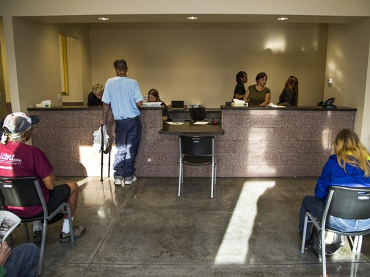 People wait in the lobby of the new Brian Garcia Welcome