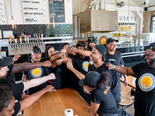 Store manager Omar Humphrey breaks down the Slim & Husky Team after their 10 a.m. meeting on Wednesday, May 9, 2018 in Nashville. Emanuel Reed, Clint Gray and Derrick Moore founded Slim & Husky's Pizza Beeria on Buchanan street in North Nashville in 2017. They will open another location in nearby Antioch in June 2018, and hope to expand to other cities in the Southeast within the next year.