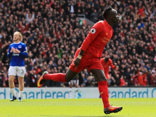 Liverpool's Sadio Mane celebrates scoring his side's first goal, during the English Premier League soccer match between Liverpool and Everton, at Anfield, in Liverpool, England, Saturday April 1, 2017. (Peter Byrne/PA via AP)
