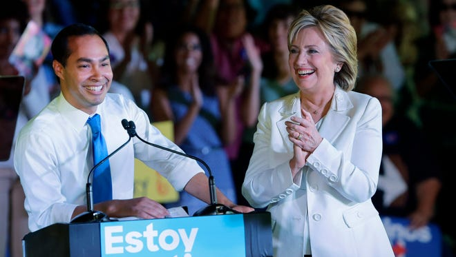 Housing and Urban Development Secretary Julian Castro and Democratic presidential candidate Hillary Clinton take part in a campaign event in San Antonio on Oct. 15, 2015.