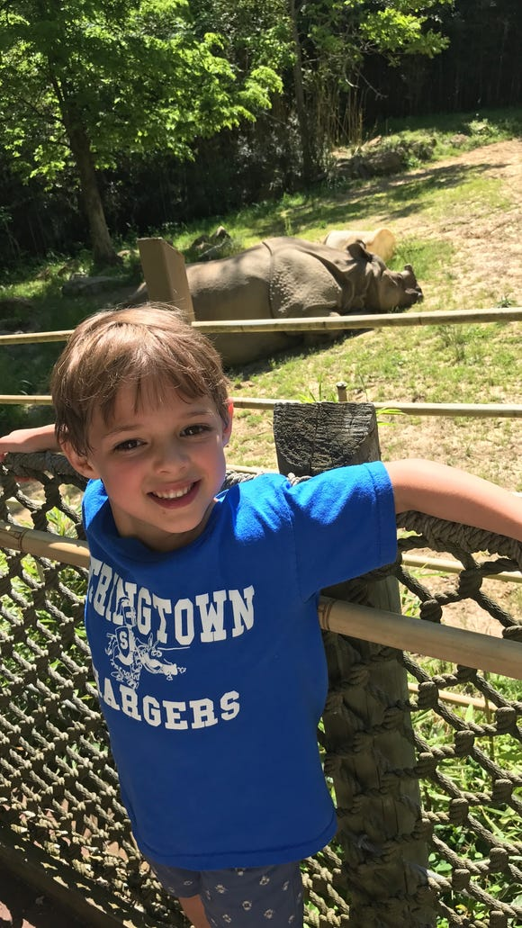 Miles posing with a hippo during the class' recent