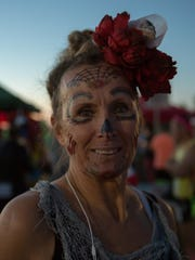 Pam Jones, from Cape Girardeau, Missouri, with Dia de Los Muertos face paint on, as the sun comes up at La Llorona Park minutes before running in the the first day of the Day of the Dead Marathon Series, put on by Mainly Marathons, Saturday Oct. 29, 2016.