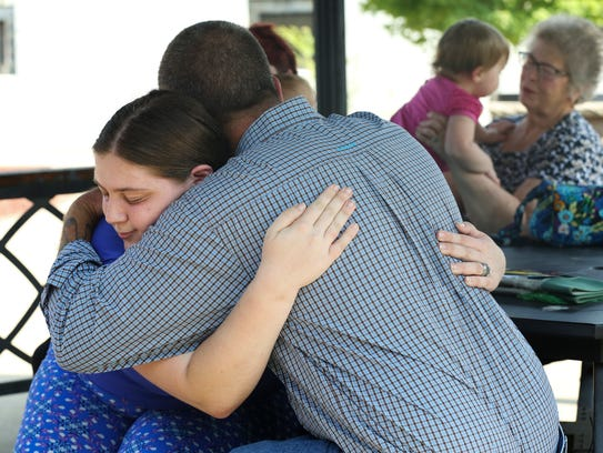 Emily Ernspiker, 23, left, embraced Dave Triola as