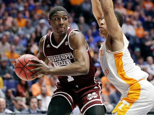 Mississippi State forward Reggie Perry, left, is defended by Tennessee's Grant Williams, right, in the first half of an NCAA college basketball game at the Southeastern Conference tournament Friday, March 15, 2019, in Nashville, Tenn. (AP Photo/Mark Humphrey)