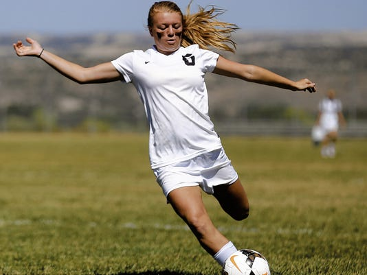 Aztec's Autumn Petersen takes a shot at the Los Lunas goal Saturday during a match at the Aztec Sports Complex.