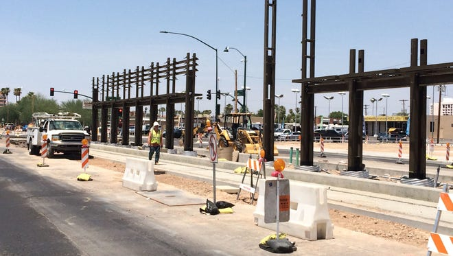 Construction moves forward on a light-rail station at Main Street and Mesa Drive, part of a 3.1-mile extension through downtown Mesa, opening fall 2015.