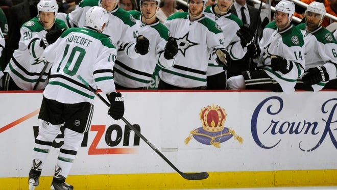 Dallas Stars center Shawn Horcoff (10) celebrates with teammates after an assist to Dallas Stars left wing Ryan Garbutt (not pictured) for a score against the Anaheim Ducks.