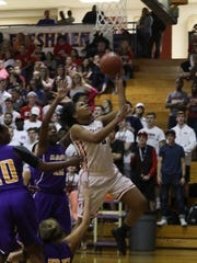 Rossview's Semajia Ogburn (#2) goes up for two against