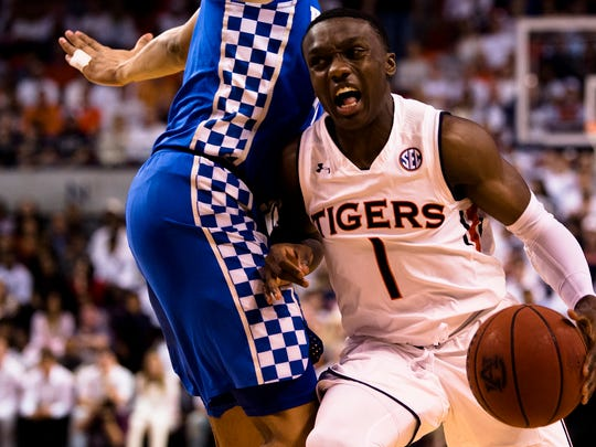 Auburn Tigers guard Jared Harper (1) drives against