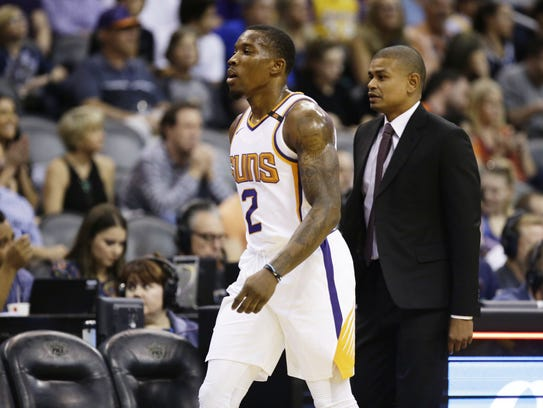 Suns guard Eric Bledsoe heads to the bench after coach