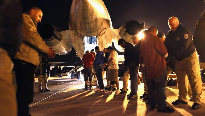 MESA, AZ - DECEMBER 08:  Immigration and Customs Enforcement (ICE), officers pat down undocumented  immigrants from El Salvador before boarding them onto a deportation flight on December 8, 2010 in Mesa, Arizona. Of the 111 Salvadorians on the flight, most had criminal records. Although illegal immigration to the United States has decreased nationally in the last few years, ICE deported almost 400,000 people in the last year, which is a record. Of that number, almost half had criminal records. The Obama administration has made targeting undocumented workers with criminal records a priority in its immigration enforcement policy.  (Photo by John Moore/Getty Images)