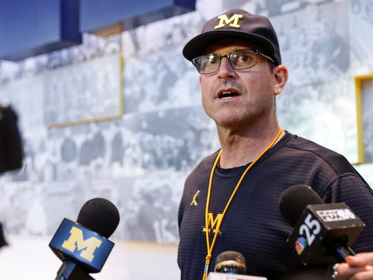 U-M football head coach Jim Harbaugh speaks with media during a press conference at the Towsley Museum in Schembechler Hall in Ann Arbor, Friday, August 11.